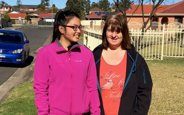 Active Ability exercise physiologist Izzy standing on grass beside client Suzie before walking together as part of Suzie's mental and physical health program.